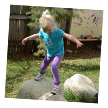 Kid playing on rocks